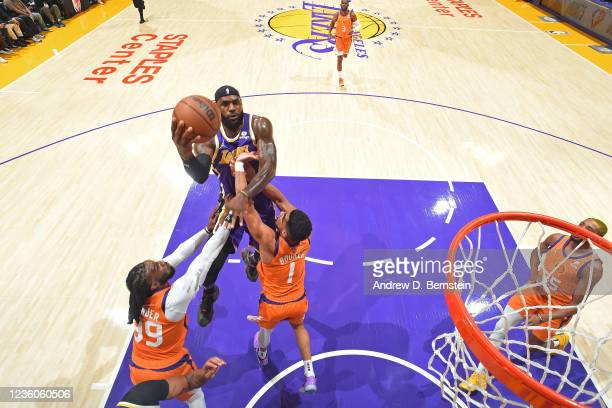 LeBron James of the Los Angeles Lakers drives to the basket against the Phoenix Suns on October 22, 2021 at STAPLES Center in Los Angeles,...