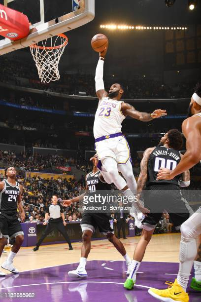LeBron James of the Los Angeles Lakers drives to the basket during the game against Harrison Barnes of the Sacramento Kings on March 24 2019 at...