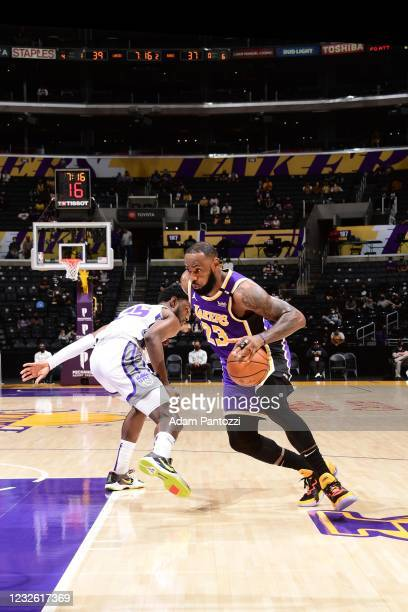 LeBron James of the Los Angeles Lakers drives to the basket during the game against the Sacramento Kings on April 30, 2021 at STAPLES Center in Los...