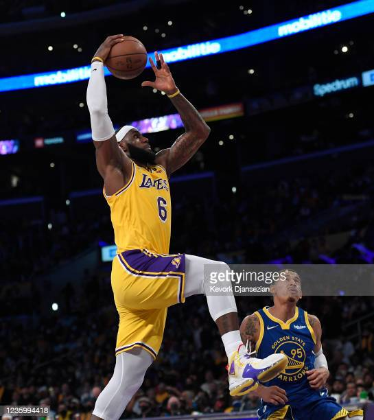 LeBron James of the Los Angeles Lakers drives to the basket during the second half against Juan Toscano-Anderson of the Golden State Warriors at...