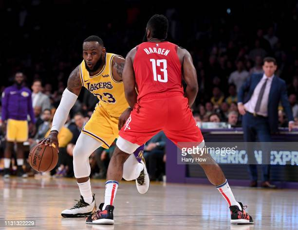 LeBron James of the Los Angeles Lakers drives to the basket in front of James Harden of the Houston Rockets during a 111106 Lakers win at Staples...