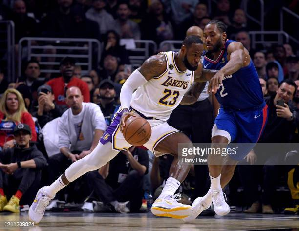 LeBron James of the Los Angeles Lakers drives to the basket on Kawhi Leonard of the LA Clippers during the first half at Staples Center on March 08...
