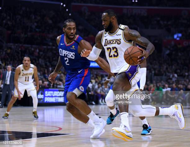 LeBron James of the Los Angeles Lakers drives to the basket on Kawhi Leonard of the LA Clippers during a 112-103 Lakers win at Staples Center on...