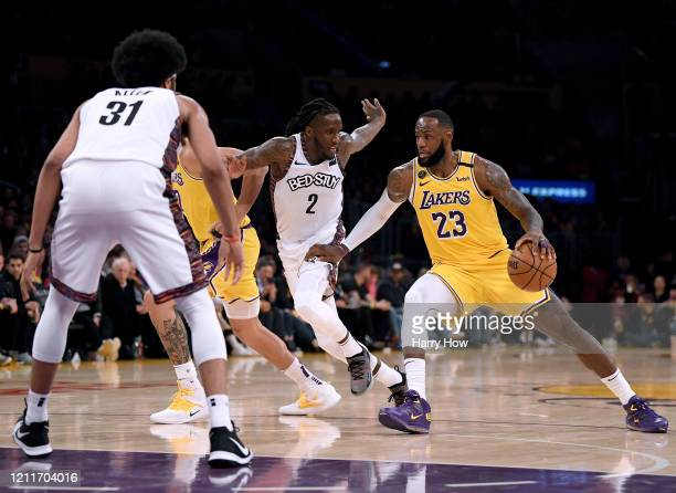 LeBron James of the Los Angeles Lakers drives to the basket on Taurean Prince of the Brooklyn Nets and Jarrett Allen during a 104102 Nets win at...
