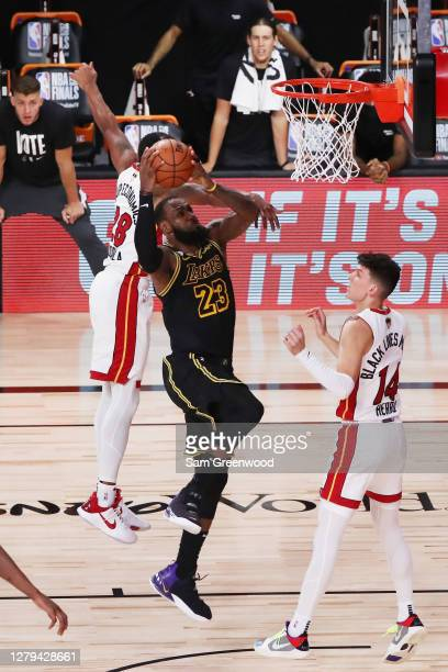 LeBron James of the Los Angeles Lakers drives to the basket over Tyler Herro of the Miami Heat during the fourth quarter in Game Five of the 2020 NBA...