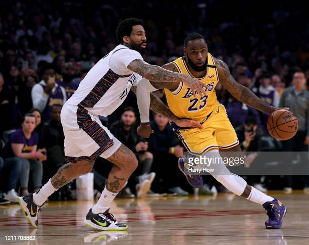 LeBron James of the Los Angeles Lakers drives to the basket past Wilson Chandler of the Brooklyn Nets during a 104102 Nets win at Staples Center on...