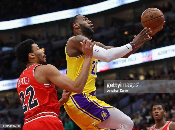 LeBron James of the Los Angeles Lakers drives to the basket past Otto Porter Jr #22 of the Chicago Bulls at the United Center on March 12 2019 in...