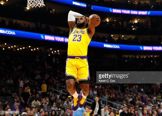 LeBron James of the Los Angeles Lakers dunks against the Atlanta Hawks in the first half at State Farm Arena on December 15, 2019 in Atlanta,...