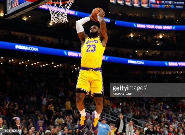 LeBron James of the Los Angeles Lakers dunks against the Atlanta Hawks in the first half at State Farm Arena on December 15 2019 in Atlanta Georgia...