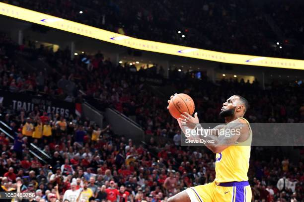 LeBron James of the Los Angeles Lakers dunks against the Portland Trail Blazers in the first quarter of their game at Moda Center on October 18 2018...