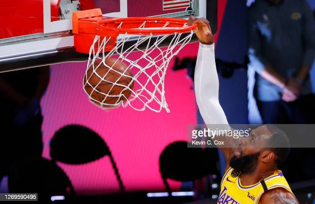 LeBron James of the Los Angeles Lakers dunks against the Portland Trail Blazers during the first quarter in Game Five of the Western Conference First...