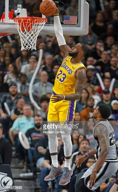 LeBron James of the Los Angeles Lakers dunks past Rudy Gay of the San Antonio Spurs at ATT Center on October 27 2018 in San Antonio Texas NOTE TO...