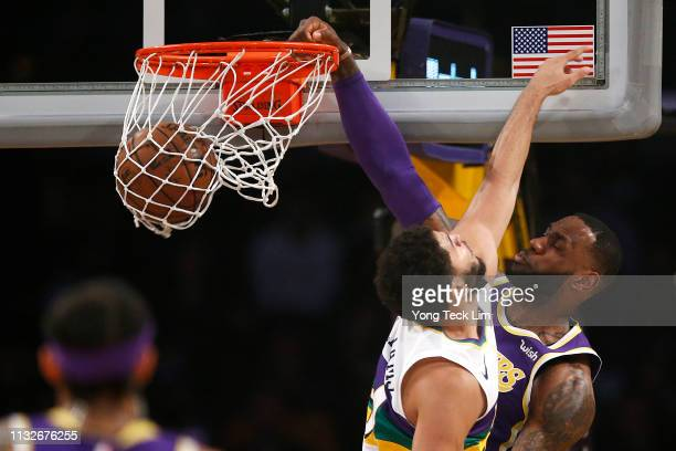 LeBron James of the Los Angeles Lakers dunks the ball against Kenrich Williams of the New Orleans Pelicans during the first half at Staples Center on...