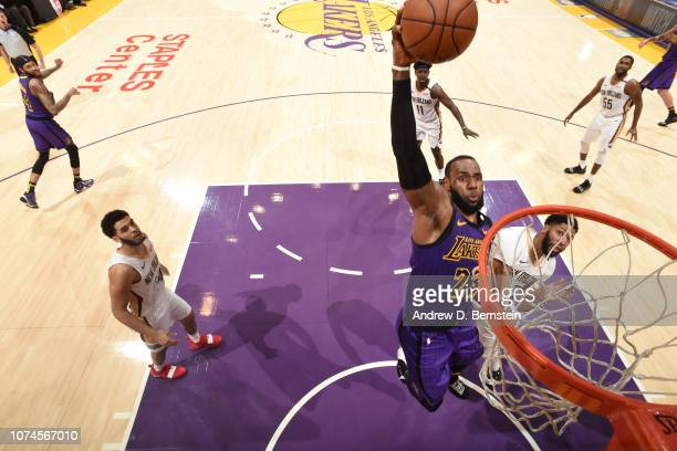 LeBron James of the Los Angeles Lakers dunks the ball against the New Orleans Pelicans on December 21 2018 at STAPLES Center in Los Angeles...