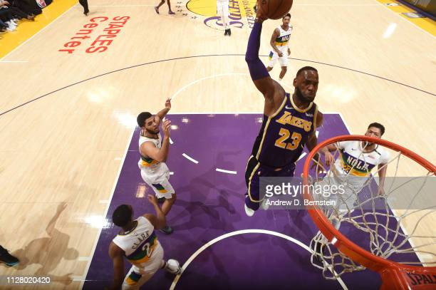 LeBron James of the Los Angeles Lakers dunks the ball against the New Orleans Pelicans on February 27 2019 at STAPLES Center in Los Angeles...