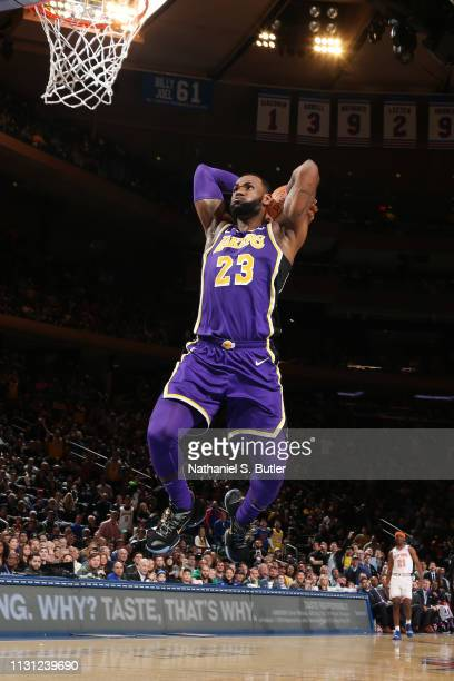 LeBron James of the Los Angeles Lakers dunks the ball against the New York Knicks on March 17 2019 at Madison Square Garden in New York City New York...