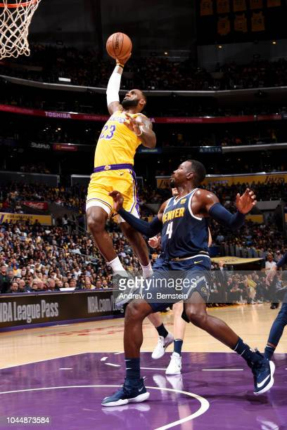 LeBron James of the Los Angeles Lakers dunks the ball against the Denver Nuggets during a preseason game on October 2 2018 at STAPLES Center in Los...