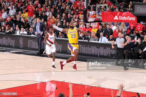 LeBron James of the Los Angeles Lakers dunks the ball against the Portland Trail Blazers on October 18 2018 at the Moda Center in Portland Oregon...