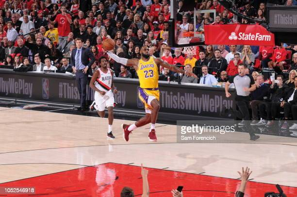 LeBron James of the Los Angeles Lakers dunks the ball against the Portland Trail Blazers on October 18 2018 at the Moda Center Arena in Portland...