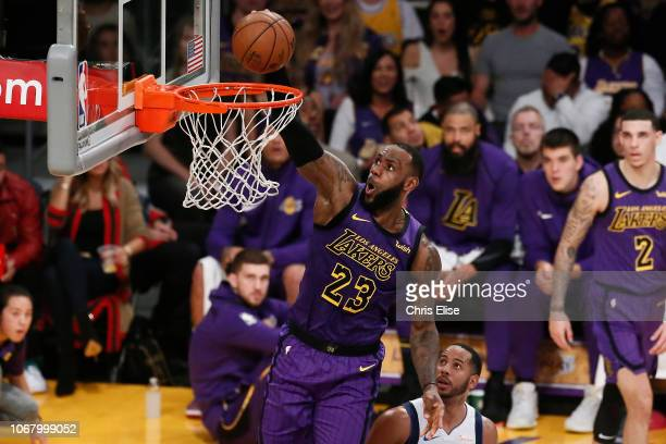 LeBron James of the Los Angeles Lakers dunks the ball against the Dallas Mavericks on November 30 2018 at the Staples Center in Los Angeles...