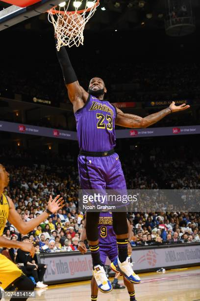 LeBron James of the Los Angeles Lakers dunks the ball against the Golden State Warriors on December 25 2018 at ORACLE Arena in Oakland California...