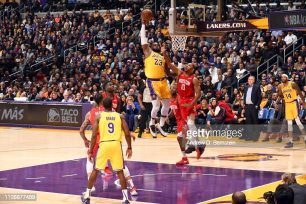 LeBron James of the Los Angeles Lakers dunks the ball against the Houston Rockets on February 21 2019 at STAPLES Center in Los Angeles California...
