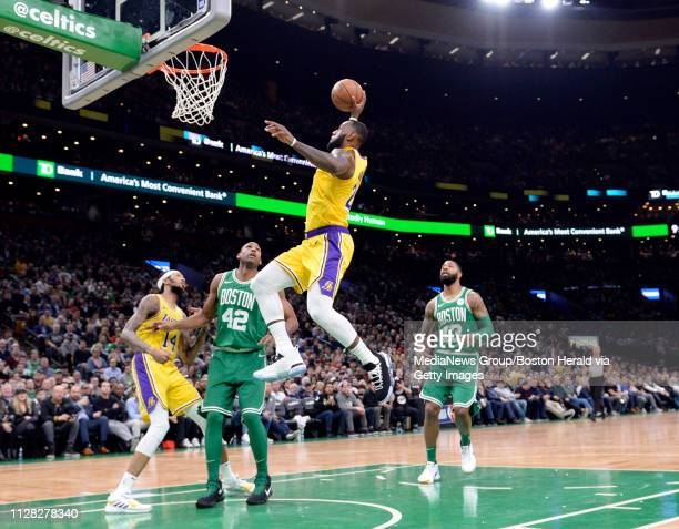 LeBron James of the Los Angeles Lakers dunks the ball against the Boston Celtics during the second quarter of an NBA basketball game at TD Garden in...
