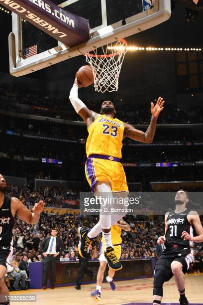 LeBron James of the Los Angeles Lakers dunks the ball against the Washington Wizards on March 26 2019 at STAPLES Center in Los Angeles California...
