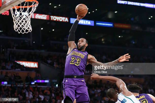 LeBron James of the Los Angeles Lakers dunks the ball against the Charlotte Hornets on March 29 2019 at STAPLES Center in Los Angeles California NOTE...