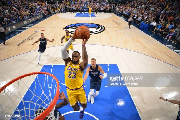 LeBron James of the Los Angeles Lakers dunks the ball against the Dallas Mavericks on November 1 2019 at the American Airlines Center in Dallas Texas...