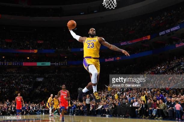 LeBron James of the Los Angeles Lakers dunks the ball against the Philadelphia 76ers on January 25 2020 at the Wells Fargo Center in Philadelphia...