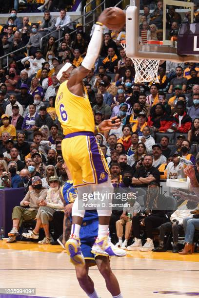 LeBron James of the Los Angeles Lakers dunks the ball against the Golden State Warriors on October 19, 2021 at STAPLES Center in Los Angeles,...