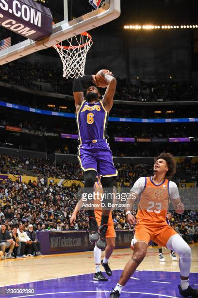 LeBron James of the Los Angeles Lakers dunks the ball against the Phoenix Suns on October 22, 2021 at STAPLES Center in Los Angeles, California. NOTE...
