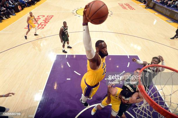 LeBron James of the Los Angeles Lakers dunks the ball during the game against the Milwaukee Bucks on March 6 2020 at STAPLES Center in Los Angeles...