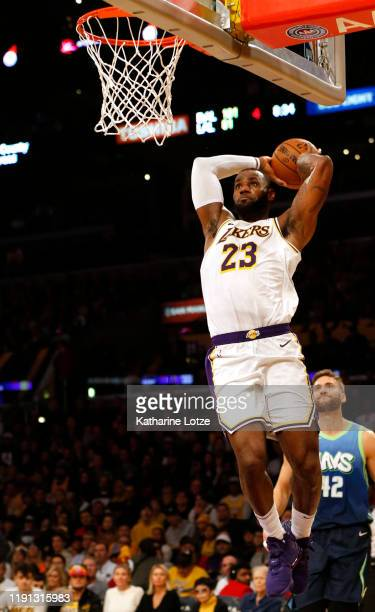 LeBron James of the Los Angeles Lakers dunks the ball during the second half against the Dallas Mavericks at Staples Center on December 01 2019 in...