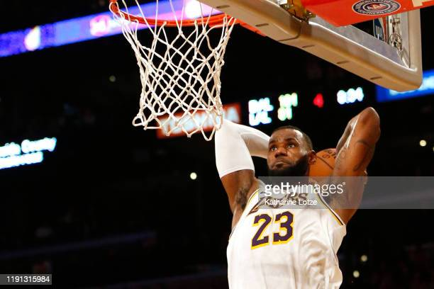 LeBron James of the Los Angeles Lakers dunks the ball during the second half against the Dallas Mavericks at Staples Center on December 01, 2019 in...