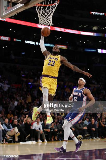 LeBron James of the Los Angeles Lakers dunks the ball in a game against the Philadelphia 76ers during the second half at Staples Center on March 03,...