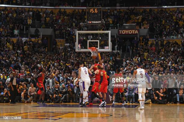 LeBron James of the Los Angeles Lakers dunks the game winning basket against the Atlanta Hawks on November 11 2018 at STAPLES Center in Los Angeles...