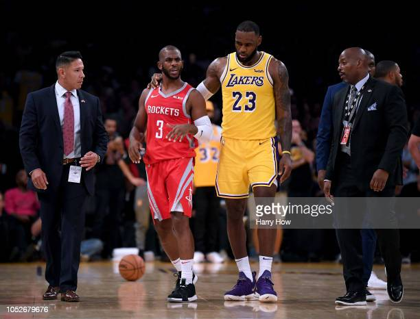 LeBron James of the Los Angeles Lakers escorts Chris Paul of the Houston Rockets after a fight involving Rajon Rondo and Brandon Ingram during a...