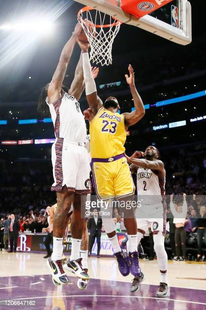 LeBron James of the Los Angeles Lakers fights for the rebound with DeAndre Jordan of the Brooklyn Nets during a game at the Staples Center on March...