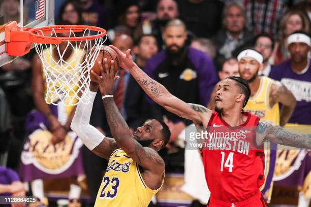 LeBron James of the Los Angeles Lakers goes for a layup against Gerald Green of the Houston Rockets during the first half at Staples Center on...