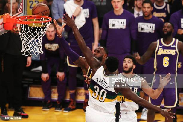 LeBron James of the Los Angeles Lakers goes for a layup against Julius Randle of the New Orleans Pelicans during the first half at Staples Center on...