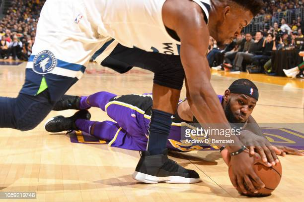 LeBron James of the Los Angeles Lakers goes for a loose ball with Jimmy Butler of the Minnesota Timberwolves on November 7 2018 at STAPLES Center in...