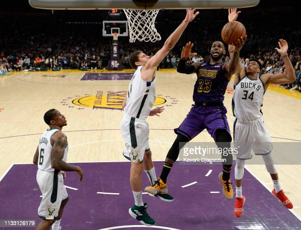 LeBron James of the Los Angeles Lakers goes for the layup against Brook Lopez of the Milwaukee Bucks during the game at Staples Center on March 01...