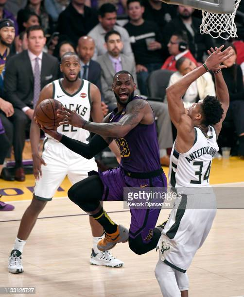 LeBron James of the Los Angeles Lakers goes for the layup agaisnt Giannis Antetokounmpo of the Milwaukee Bucks during the game at Staples Center on...