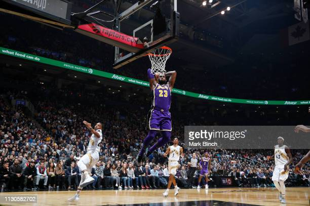LeBron James of the Los Angeles Lakers goes up for a dunk during the game against the Toronto Raptors on March 14 2019 at the Scotiabank Arena in...