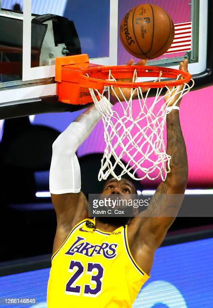 LeBron James of the Los Angeles Lakers goes up for a shot against the Sacramento Kings during the second quarter at The Field House at ESPN Wide...