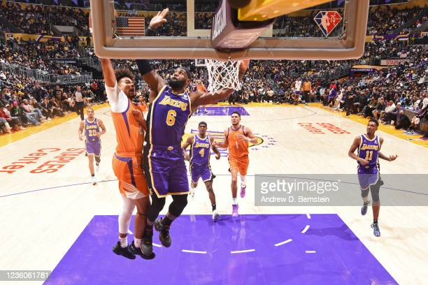 LeBron James of the Los Angeles Lakers goes up to block the shot of Cameron Johnson of the Phoenix Suns on October 22, 2021 at STAPLES Center in Los...