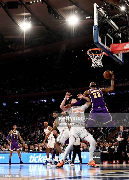 LeBron James of the Los Angeles Lakers grabs a rebound during the second half of the game against the New York Knicks at Madison Square Garden on...