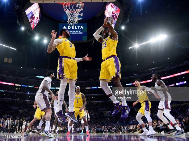 LeBron James of the Los Angeles Lakers grabs a rebound in front of Anthony Davis during a 104102 loss to the Brooklyn Nets at Staples Center on March...